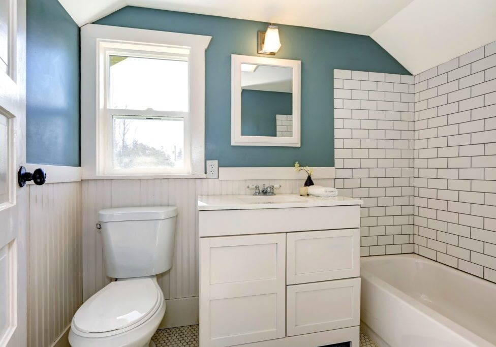 Bathroom interior with tile and plank wall trim